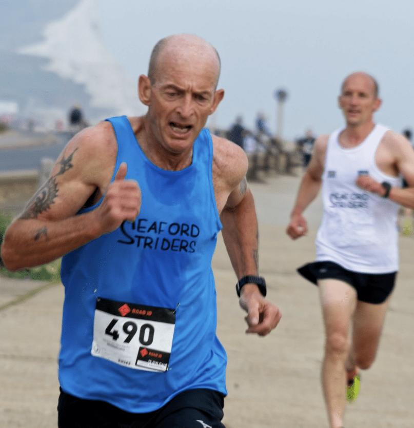 Group running 10K run along Seaford Seafront